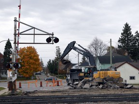 A construction excavator digs up asphalt surrounding the CN rail lines on Wilson Avenue and prepares to place it in a dump truck in Woodstock, Ont. on Monday November 4, 2019. CN crews are working on the rail lines and are expected to finish by the end of the week. (Greg Colgan/Woodstock Sentinel-Review)