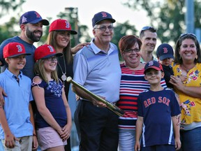 Jamie Corke (centre),  a former Brantford Red Sox player and longtime umpire who passed away Dec. 6, is surrounded by his family in this photo when he was recognized by the Red Sox for his inclusion on the Intercounty Baseball League's list of its top-100 players. Photo courtesy Crystal Young Photography