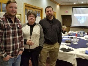 Please Bring Me Home founders Nick Oldrieve, left, and Matt Nopper, right, with retired RCMP officer Linda Gillis Davidson, at an organizational meeting at a local hotel on Friday, Dec. 20, 2019 in Owen Sound. Scott Dunn/The Owen Sound Sun Times/Postmedia Network