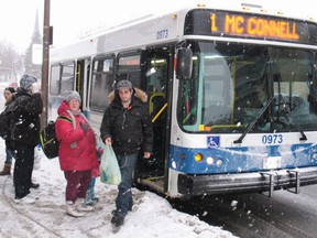 Passengers getting on and off Cornwall Transit, on a snowy day in downtown Cornwall, Wednesday,  Feb. 4, 2015.