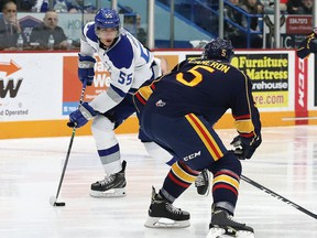 Quinton Byfield, left, of the Sudbury Wolves, attempts to skate around Christopher Cameron, of the Barrie Colts, during OHL action at the Sudbury Community Arena in Sudbury, Ont. on Friday November 29, 2019.