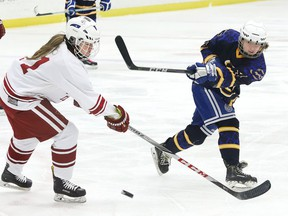Carissa Baron, right, of Bishop Alexander Carter Golden Gators, fires the puck past Marley Turcotte, of St. Charles Cardinals, during girls high school hockey action at the Garson Arena in Garson, Ont. on Wednesday January 15, 2020.