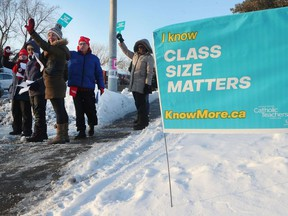 Teachers held an information picket at Our Lady of Mount Carmel in Ottawa, Friday. Tony Caldwell