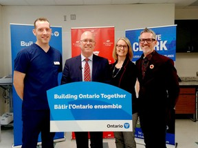 Nursing student Jordan McCann, left, MPP Steve Clark, president and CEO of Colleges Ontario Linda Franklin, and St. Lawrence College president Glenn Vollebregt pose during Friday's announcement. (SABRINA BEDFORD/The Recorder and Times)