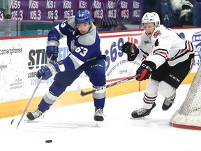 Liam Ross, left, of the Sudbury Wolves, eludes Isaac Enright, of the Niagara IceDogs, during OHL action at the Sudbury Community Arena in Sudbury, Ont. on Friday February 28, 2020. John Lappa/Sudbury Star/Postmedia Network