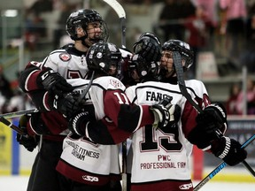 Chatham Maroons' Lucas Fancy (19) is congratulated after scoring in the third period against the LaSalle Vipers at Chatham Memorial Arena in Chatham, Ont., on Saturday, March 7, 2020. Fancy had a hat trick in the Maroons' 5-3 loss. Mark Malone/Chatham Daily News/Postmedia Network