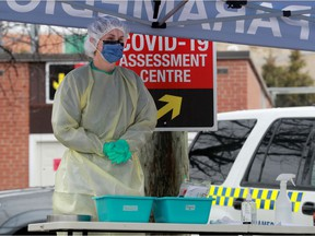 Nurses take COVID-19 swabs at a drive-through testing site outside the Almonte General Hospital recently.