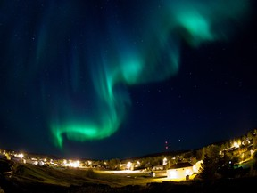 Northern lights fill the sky over Monument Hill in Fort Chipewyan, Alta. on September 13, 2013. Ryan Jackson/Postmedia Network