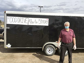 Real Chartrand of Spruce Grove poses with one of the supply trailers he recently ran up to Fort McMurray. The area resident previously lived in the community and lost everything during the fires that ravaged the region previously.