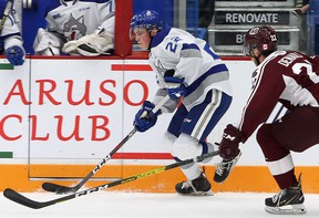 Sudbury Wolves defenceman Jack Thompson (22) plays the puck while under pressure from Peterborough Petes forward Chad Denault (22) during first-period OHL action at Sudbury Community Arena in Sudbury, Ontario on Friday, October 4, 2019.
