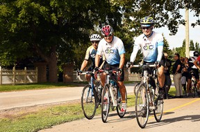 Joseph Sebben, Randy Perdu and Rand MacIntosh ride their bicycles along Phase 1 of the Round the River Recreational Trail along Grand Avenue West in Chatham in August 2019. Tom Morrison/Postmedia