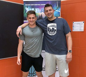 Kyle Beers, head of operations for Northern Lights Basketball Academy, right, poses for a photo with Noah LaPierre, one of his instructors for the summer driveway training program.