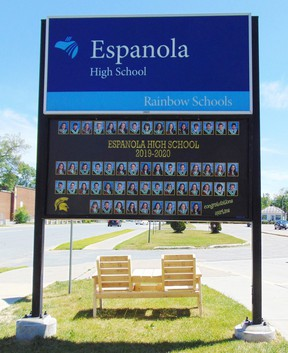 Photo by Helen Morley/For The Mid-North MonitorA banner placed just under the Espanola High School sign features the graduating class of 2019-2020.