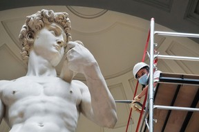 A restorer cleans Michelangelo's David statue while preparing for the reopening of the Galleria dell'Accademia which was closed for almost three months due to coronavirus on May 27 in Florence, Italy. The reopening was scheduled to take place on June 2nd.