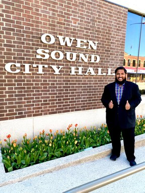 Waleed Aslam stands in front of Owen Sound city hall. SUPPLIED