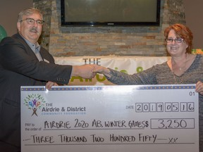 The Airdrie Community Foundation provides funding to local non-profits for worthwhile projects. In 2019, Chair Dale Rathgeber is seen presenting a cheque for $3,250 to Wendy Potter to support the 2020 Winter Games at the third annual Airdrie Community Foundation Gala. Photo by Kelsey Yates
