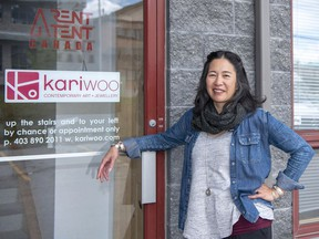 Jeweler Kari Woo wears some of her silver creations as she stands in front of her studio in the Elk Run Industrial Park in Canmore. photo by Pam Doyle/www.pamdoylephoto.com