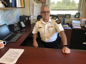 Prince Edward County Fire Chief Scott Manlow is pictured in his McDonald Drive office in Picton. Manlow will hang up his fire hat on June 30 after 32 years, including the last 14 as chief.