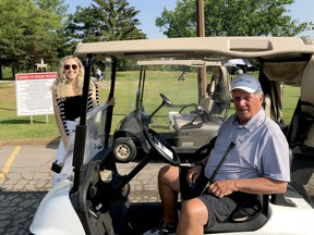 Lauren Phillips, event manager at the Brockville and District Hospital Foundation, poses with Friends of Palliative Care Golf Tournament co-chairman Dave Publow at the Brockville Country Club on Tuesday morning. (RONALD ZAJAC/The Recorder and Times)