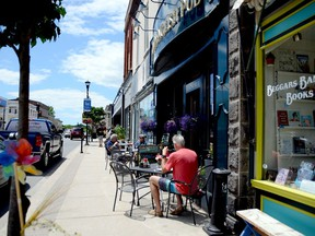 By closing King Street to vehicular traffic, patios such as this one in front of the Old English Pub will be able to expand out to take up the vacant parking spaces while pedestrians will be able to stroll safely down the centre lanes, maintaining social distancing.