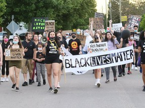 Marchers take part in a Black Lives Matter demonstration on King Street in Chatham on June 5. Mark Malone/Postmedia Network