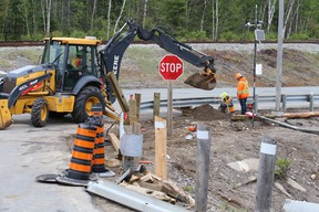 Crews clean up after tractor-trailer flipped, spilling logs on Highway 144 in Greater Sudbury, Ontario on Tuesday, June 2, 2020.