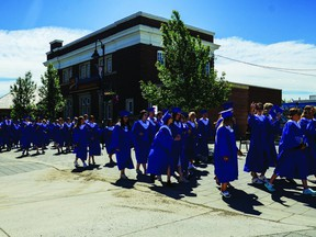 Highwood High School's graduating class last year paraded down the street in their gowns June 28, 2019 from the Museum of the Highwood to George Lane Park, where the graduation ceremony took place.