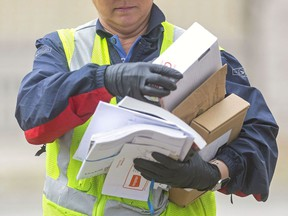 Canada Post set a one-day delivery record May 19 with 2.1 million parcels. Postmedia Photo