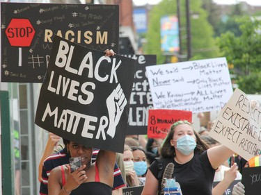 Participants chant as they walk through Pembroke's downtown core during a Black Lives Matter rally called Pembroke's March Against Injustice on Tuesday, June 9. Anthony Dixon