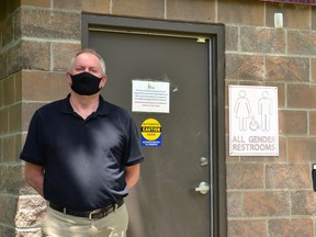 Stratford community facilities manager Jim Bryson poses next to the North Shore washroom, one of four washrooms around Stratford's Lake Victoria that will be reopened to the public this Saturday. (Galen Simmons/The Beacon Herald)