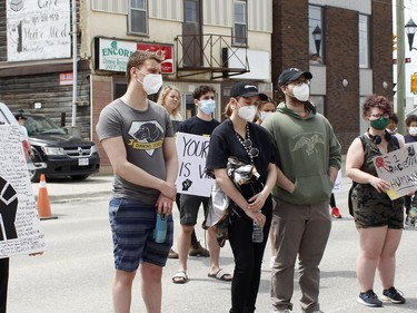 Participants in Friday's anti-racism rally are gathered in front of Timmins city hall, listening to the various speakers. The event was during the noon hour.   RICHA BHOSALE/The Daily Press