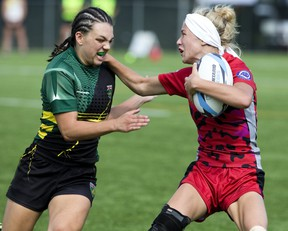 Kendra Cousineau of Niagara Rugby Union One, left, moves in to tackle Allison Stevenson of the Southwest Warriors during their Ontario Summer Games rugby match in London in 2018. London was set to host the Games again this summer, but on Monday the province finally pulled the plug and will let London host them in 2021. (Free Press file photo)