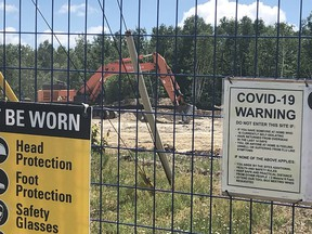 An excavator can be seen in the background on the site of a large development on Falconbridge Road on Garson that will feature a gas station and car wash, convenience store and A&W restaurant. HAROLD CARMICHAEL/SUDBURY STAR