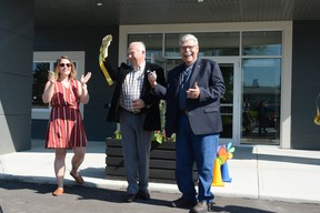 Stephanie Smith, director of the Pincher Creek Community Early Learning Centre, Town of Pincher Creek Mayor Don Anderberg, middle, and M.D. of Pincher Creek Reeve Brian Hammond do the honours July 3 of cutting the ribbon, commemorating the opening of the Sage Early Learning Centre, located by St. Michael's School.