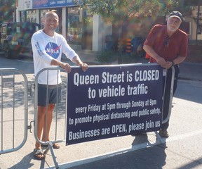Fraser and Rick Clarke of the Kincardine BIA set up the barricades indicating the first night of the Downtown Promenade on Friday, July 3.