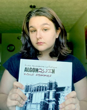 Hailey Brousseau holds up a copy of the 2020 Ecole Secondaire Catholique Algonquin yearbook. An error left one student from the graduating class off its pages, but the book will be reprinted.Submitted Photo