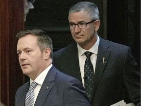 Alberta Premier Jason Kenney, left, and Alberta Finance Minister Travis Toews, right.