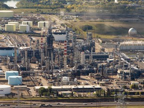 """An aerial view of the Suncor refinery in Edmonton on Sept. 10, 2015. The plant leaked hydrogen sulphide on July 18, 2018, sending a """"handful"""" of workers to hospital. That incident has lead to the province issuing seven environmental charges against Suncor Energy. RYAN JACKSON/Edmonton Journal"""