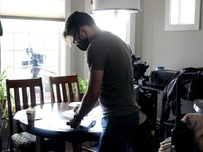 Camera assistant Ben Vanderlinden sets up for a new scene in Connecting Flights Friday in the Town of Stony Plain. The film, which has a $250,000 budget, is one of the first to resume in the province after the shutdowns.