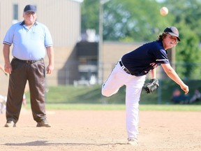 Chatham's Everitt Swayze delivers a pitch as home-plate umpire Bob Daly watches during Game 1 of an exhibition major peewee doubleheader against London at Memorial Park in Blenheim, Ont., on Sunday, July 26, 2020. Daly was positioned behind the pitcher because of Baseball Ontario's new rules during the COVID-19 pandemic. Mark Malone/Chatham Daily News/Postmedia Network