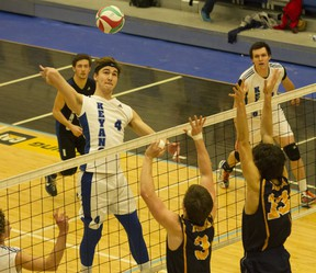 Justin Delorme, left, of the Keyano Huskies men's volleyball team rises up for a kill attempt during ACAC men's volleyball action against the Concordia Thunder at the Syncrude Sport and Wellness Centre in Fort McMurray Alta. on Friday February 10, 2017. Robert Murray/Fort McMurray Today/Postmedia Network