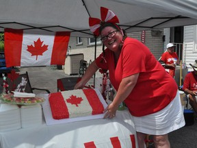 Following the singing of the anthem, the group were rewarded with a Canadian flag cake. Photo taken on Wednesday July 1, 2020 in Cornwall, Ont. Francis Racine/Cornwall Standard-Freeholder/Postmedia Network