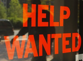 A 'Help Wanted' sign in the window advertises a job opening at a dry cleaners in Boston