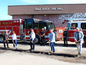 Members of High River Town Council and the High River Fire Department stand by as shovels hit the ground on June 22, officially commencing the long-awaited renovations to the High River fire hall.