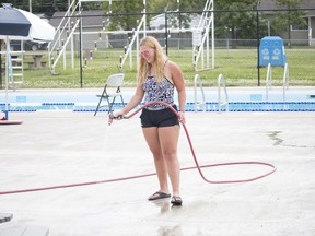 Haley Stark was seen washing down the pool's deck last week. The pool is open for limited activities. Brigette Moore