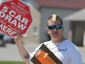 Cole Speers sells tickets for Sault Area Hospital Foundation's 5 Car Draw in June 2015. BRIAN KELLY