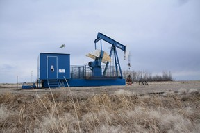 A blue-and-white pumpjack is stationary south of Fairview, Alta. on Saturday, April 25, 2020.