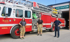 The Norfolk County Fire Department is looking for 22 individuals able to fill volunteer positions across the community. Marcia VanHaverbeke and Doug Rixmann, both volunteers at the Simcoe location, stand with Deputy Chief Scott Pipe at the fire station on Culver Street. (ASHLEY TAYLOR)