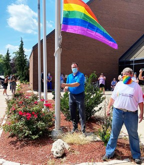 Chatham-Kent Mayor Darrin Canniff is joined by Marianne Willson, CK Pride president, in raising the Pride flag on Monday, marking the beginning of Pride Week in Chatham-Kent.