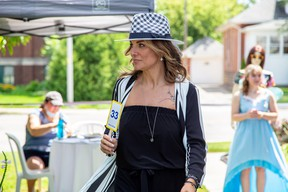 Gentry Manor held an outdoor and socially-distant fashion show Friday. The models held numbers which allowed guests to order clothing from their tables. (Handout/Postmedia Network)